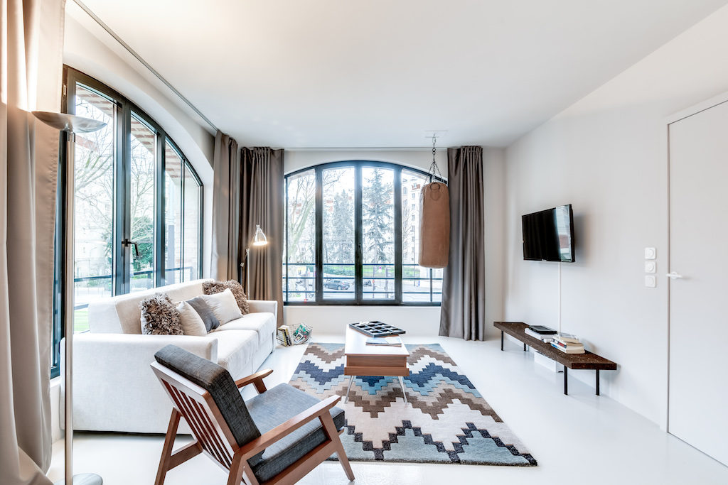 a bright and cosy living room living-room of this urban loft in south Paris by Sweet Inn