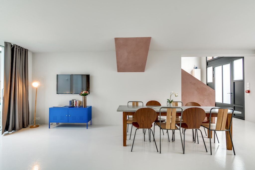 wooden furniture warms-up the dining room of this quiet townhouse in the heart of Paris by Sweet Inn