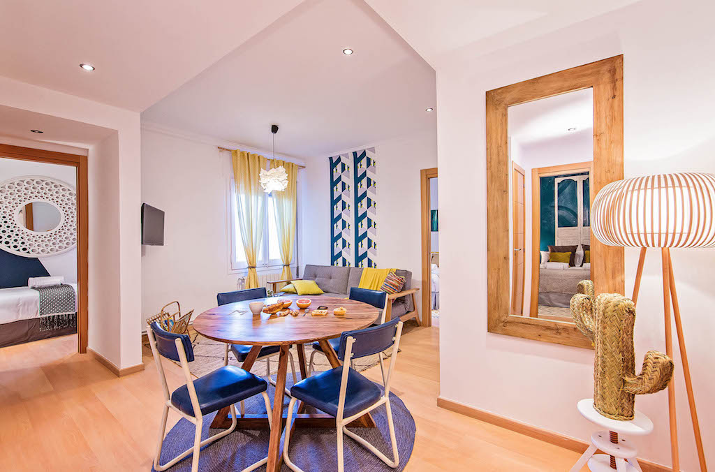 ethnic inspiration in this peaceful family apartment in the centre of Barcelona by sweet inn