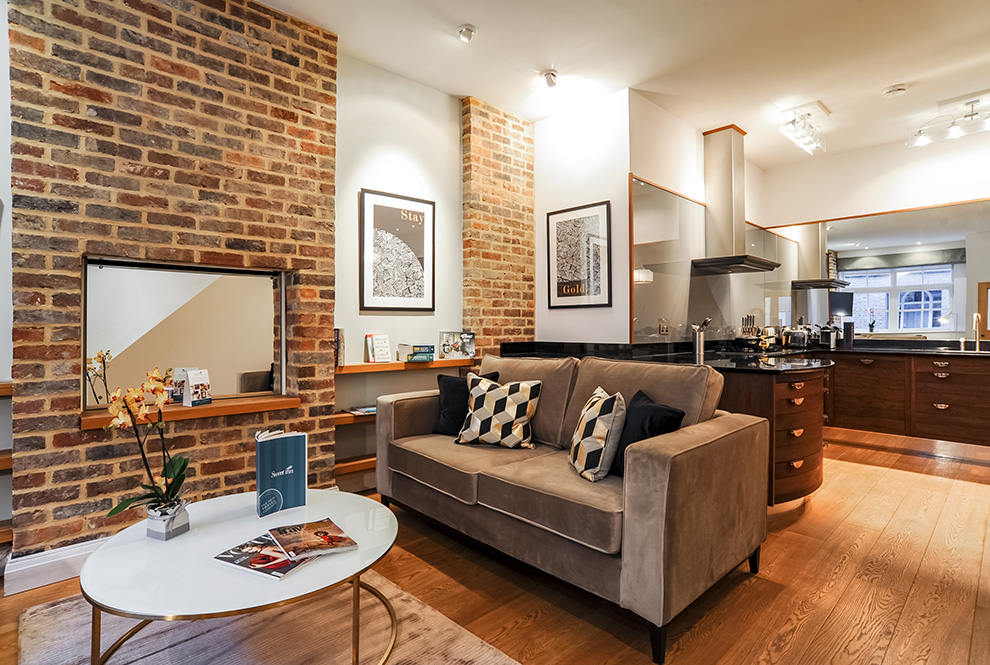 Our Local Interior Designers Have Decked Out This Vacation Apartment With  Classic, Elegant English Decor: Brick Walls, Tiled Bathrooms, And Sleek  Wooden ...